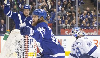 Toronto Maple Leafs right wing William Nylander, foreground, celebrates his goal on Tampa Bay Lightning goaltender Andrei Vasilevskiy, right, during the first period of an NHL hockey game Tuesday, March 10, 2020, in Toronto. (Chris Young/The Canadian Press via AP)