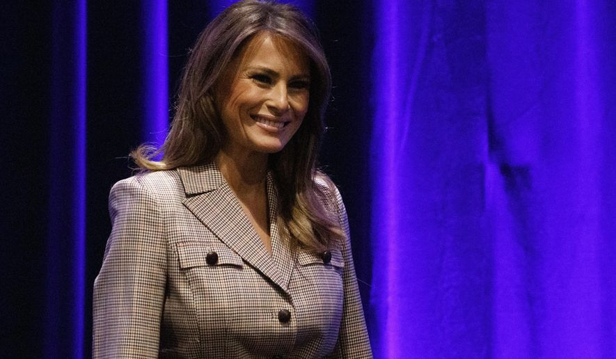 First lady Melania Trump walks from the stage after speaking at the at the National PTA Legislative Conference in Alexandria, Va., Tuesday, March, 10, 2020. (AP Photo/Carolyn Kaster)