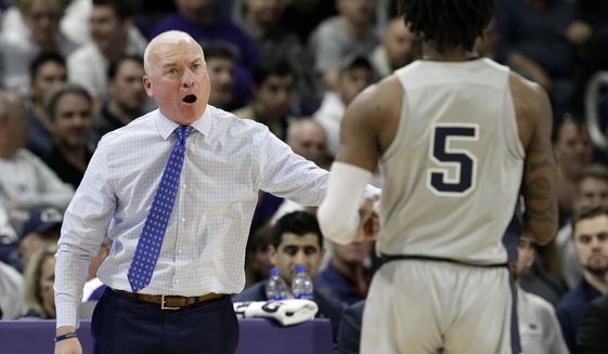 Penn State head coach Patrick Chambers, left, talks to guard Jamari Wheeler during the first half of an NCAA college basketball game against Northwestern in Evanston, Ill., Saturday, March 7, 2020. (AP Photo/Nam Y. Huh)  **FILE**