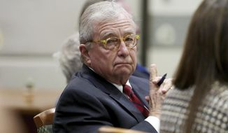Robert Durst's defense attorney Dick DeGuerin listens as opening statements in Durst's murder trial continue Monday, March 9, 2020 in Los Angeles. (Lucy Nicholson, Pool)