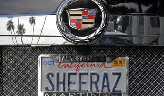 FILE- In this May 24, 2010, file photo, an SUV with a personalized license plate is seen in Beverly Hills, Calif. California may have to end most restrictions on personalized license plate language that some might find offensive, if a lawsuit filed Tuesday, March 10, 2020, prevails. (AP Photo/Damian Dovarganes, File)