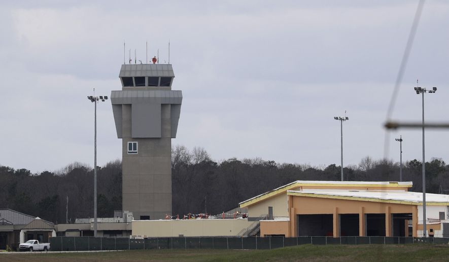 Dobbins Air Reserve Base is shown Monday, March 9, 2020, in Marietta, Ga. Thirty-four Georgians are among the U.S. citizens expected to arrive at the base on either Monday night or Tuesday morning, Georgia Gov. Brian Kemp said in a news release.(AP Photo/John Bazemore)