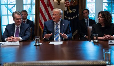 President Trump met with bankers and Wall Street executives at the White House on Wednesday including Bank of America CEO Brian Moynihan (left) and CEO of the Independent Community Bankers of America Rebeca Romero Rainey (right). All the people around the table attested to the health of the U.S. financial system. (Associated Press)