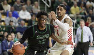 George Mason's AJ Wilson (12) moves the ball on Dayton's Obi Toppin (1) during the second half of an NCAA college basketball game, Tuesday, Feb. 25, 2020, in Fairfax, Va. Dayton won 62-55. (AP Photo/Luis M. Alvarez) **FILE**