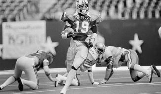 FILE - In this Nov. 7, 1981, file photo, SMU's Eric Dickerson (19) runs the ball against against Rice during the first half of an during an NCAA college football game at Texas Stadium in Irving, Texas. Dickerson, Heisman Trophy winner Eric Crouch from Nebraska and the late Steve McNair from Alcorn State are among 17 players selected for induction into the College Football Hall of Fame on Wednesday, March 11, 2020. (AP Photo/David Breslauer, File)