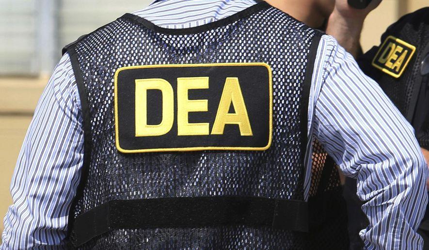 This June 13, 2016, photo shows Drug Enforcement Administration agents in Florida. (Joe Burbank/Orlando Sentinel via AP) **FILE**