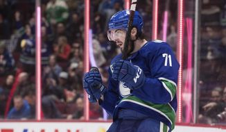 Vancouver Canucks' Zack MacEwan celebrates his goal against the New York Islanders during the second period of an NHL hockey game Tuesday, March 10, 2020, in Vancouver, British Columbia. (Darryl Dyck/The Canadian Press via AP)