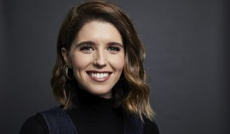 """This March 9, 2020 photo shows Katherine Schwarzenegger Pratt posing for a portrait in New York to promote her book """"The Gift of Forgiveness: Inspiring Stories from Those Who Have Overcome the Unforgivable."""" (Photo by Matt Licari/Invision/AP)"""