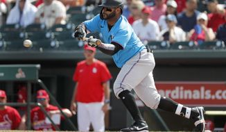 Miami Marlins' Jonathan Villar hits a sacrifice bunt to score Francisco Cervelli during the third inning of a spring training baseball game Wednesday, Feb. 26, 2020, in Jupiter, Fla. (AP Photo/Jeff Roberson)