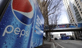 In this Jan. 30, 2019, file photo, an advertisement for Pepsi is shown downtown for the NFL Super Bowl 53 football game in Atlanta. PepsiCo says it's buying energy drink maker Rockstar Energy Beverages for $3.85 billion. (AP Photo/David J. Phillip, File)