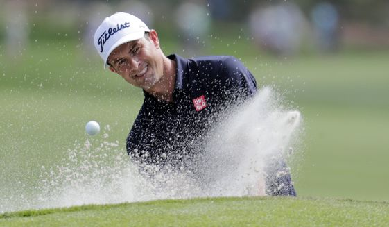 Adam Scott, of Australia, hits from a bunker on the ninth hole during a practice round for The Players Championship golf tournament, Wednesday, March 11, 2020, in Ponte Vedra Beach, Fla. (AP Photo/Lynne Sladky) ** FILE **