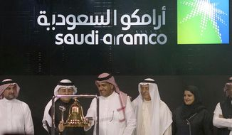 In this Dec. 11, 2019, file photo, Saudi Arabia's state-owned oil company Armco and stock market officials celebrate during the official ceremony marking the debut of Aramco's initial public offering (IPO) on the Riyadh's stock market, in Riyadh, Saudi Arabia. On April 2, 2020, President Trump said the Saudi government had assured him it was cutting back on oil production. News of the agreement gave a boost to oil prices and the stock market.  (AP Photo/Amr Nabil, File)  **FILE**