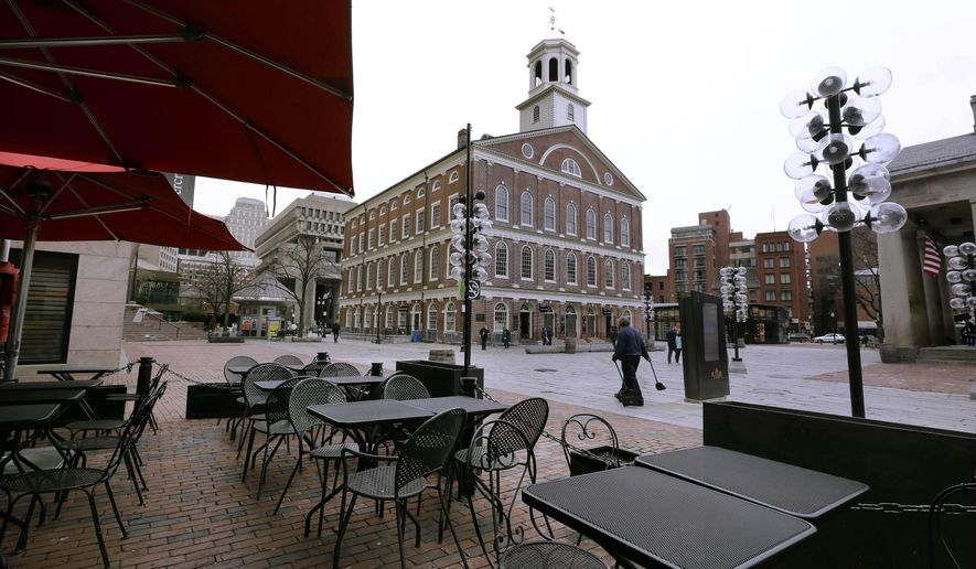 Tables are vacant in the nearly empty tourist area of Quincy Market, Wednesday, March 11, 2020, in Boston. At rear is Faneuil Hall. Public health officials in Massachusetts said Wednesday that they are monitoring more than 445 people under self-quarantine for possible symptoms of the coronavirus, which has affected global tourism and business. For most people, the virus causes only mild or moderate symptoms, such as fever and cough. For some, especially older adults and people with existing health problems, it can cause more severe illness, including pneumonia. The vast majority of people recover from the new virus. (AP Photo/Steven Senne)