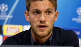 FILE - In this April 9, 2019, file photo, Juventus' Daniele Rugani answers questions during a press conference at the Johan Cruyff ArenA in Amsterdam, Netherlands. Italian soccer club Juventus announced on Wednesday, March 11, 2020, that defender Daniele Rugani has tested positive for new coronavirus. Rugani, who is also an Italy international, is the first player in Italy's top soccer division to test positive but Juventus stressed that the 25-year-old has no symptoms.  (AP Photo/Peter Dejong, File)