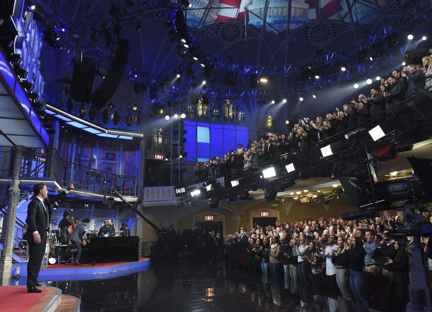 """This Feb. 4, 2020 image released by CBS shows host Stephen Colbert, left, greeting the audience during a taping of """"The Late Show with Stephen Colbert"""" in New York. The show, along with other New York-based late night talk shows """"The Tonight Show Starring Jimmy Fallon"""" and """"The Daily Show with Trevor Noah"""" will tape their shows without studio audiences due to the new coronavirus. For most people, the new coronavirus causes only mild or moderate symptoms. For some it can cause more severe illness.  (Scott Kowalchyk/CBS via AP)"""