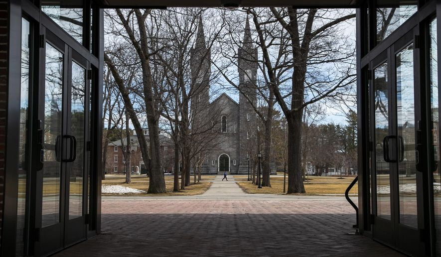 The Bowdoin College campus is nearly empty during spring break, Wednesday, March 11, 2020, in Brunswick, Maine. The school has announced that it's asking students not to return to campus following spring break and will hold classes online due to concerns about the coronavirus. Maine still has no confirmed cases of coronavirus. (AP Photo/Robert F. Bukaty)