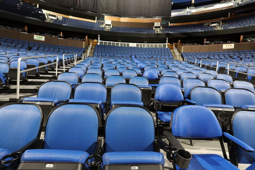 """The seats are empty at the Amway Center in Orlando, home of the NBA's Orlando Magic, on Thursday, March 12, 2020. The NBA has suspended its season until further notice"""" after a Utah Jazz player tested positive Wednesday for the coronavirus, a move that came only hours after the majority of the league's owners were leaning toward playing games without fans in arenas.  (Stephen M. Dowell /Orlando Sentinel via AP)"""