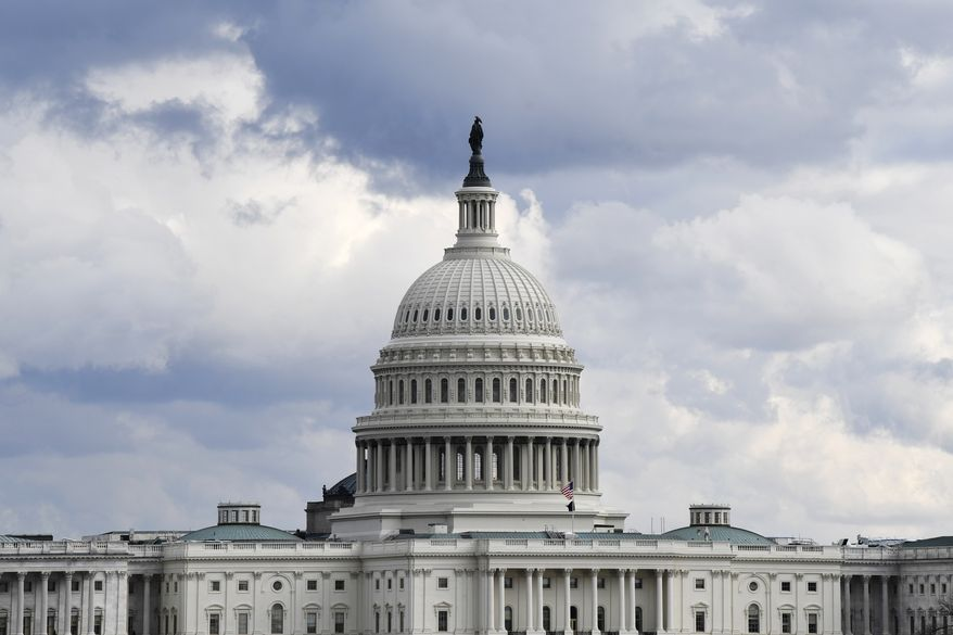 This Dec. 31, 2019, file photo shows a view of the U.S. Capitol Building in Washington. Congress is shutting the Capitol and all House and Senate office buildings to the public until April in reaction to the spread of the coronavirus. (AP Photo/Susan Walsh, File)