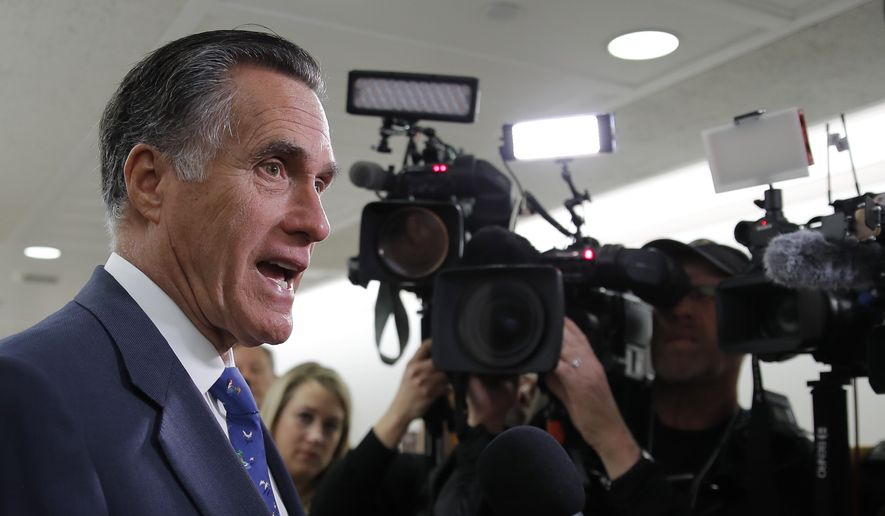 Sen. Mitt Romney, R-Utah, speaks to media as he arrives for a briefing on Capitol Hill in Washington, Thursday, March, 12, 2020, on the coronavirus outbreak. (AP Photo/Carolyn Kaster)