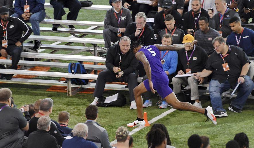 Clemson football player Tee Higgins runs the 40-yard dash during NFL Pro Day Thursday, March 12, 2020, in Clemson, S.C. (AP Photo/Richard Shiro)