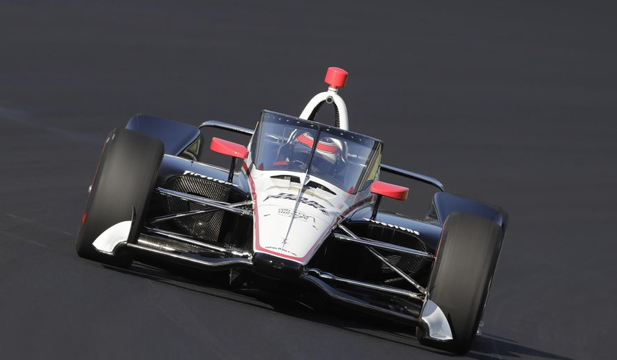 In this Wednesday, Oct. 2, 2019, file photo, Will Power, of Australia, drives into turn one during the Aeroscreen testing at Indianapolis Motor Speedway in Indianapolis. After 10 months of testing, the canopy-shaped cockpit protection is intended to protect the driver from debris. (AP Photo/Darron Cummings, File) **FILE**