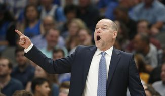 Denver Nuggets coach Michael Malone calls a play as the Nuggets played the Dallas Mavericks during the second half of an NBA basketball game Wednesday, March 11, 2020, in Dallas. The Mavericks won 113-97. (AP Photo/Ron Jenkins)  **FiLE**
