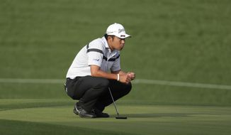 Hideki Matsuyama of Japan, studies his shot on the 12th green, during the first round of The Players Championship golf tournament Thursday, March 12, 2020 in Ponte Vedra Beach, Fla. (AP Photo/Lynne Sladky)