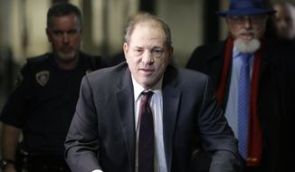 FILE - In this Feb. 20, 2020 file photo, Harvey Weinstein arrives at a Manhattan courthouse for his rape trial in New York.  Weinstein was sentenced Wednesday, March 11,  to 23 years in prison for rape and sexual assault.  (AP Photo/Seth Wenig, File)