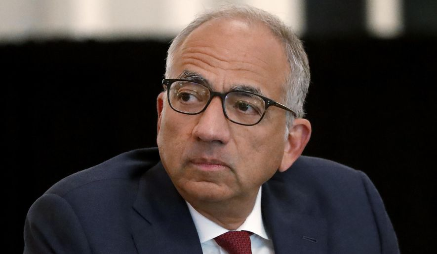In this Dec. 6, 2019, file photo, U.S. Soccer President Carlos Cordeiro presides over a meeting of the U.S. Soccer Board of Directors in Chicago. Cordeiro resigned Thursday night, March 12, 2020, three days after the organization filed legal papers in a gender discrimination claiming women players had less physical ability and responsibility than men. (AP Photo/Charles Rex Arbogast, File) **FILE**