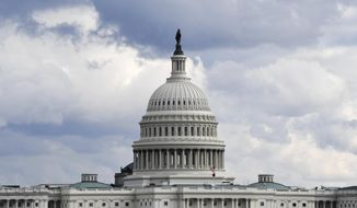 FILE - This Dec. 31, 2019, file photo shows a view of the U.S. Capitol Building in Washington. Congress is shutting the Capitol and all House and Senate office buildings to the public until April in reaction to the spread of the coronavirus. (AP Photo/Susan Walsh, File)