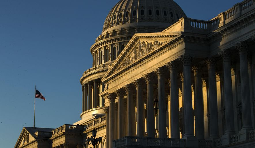 FILE - In this Dec. 18, 2019, file photo the U.S. Capitol building is illuminated by the rising sun on Capitol Hill in Washington. Congress is shutting the Capitol and all House and Senate office buildings to the public until April in reaction to the spread of the coronavirus. (AP Photo/Matt Rourke, FIle)