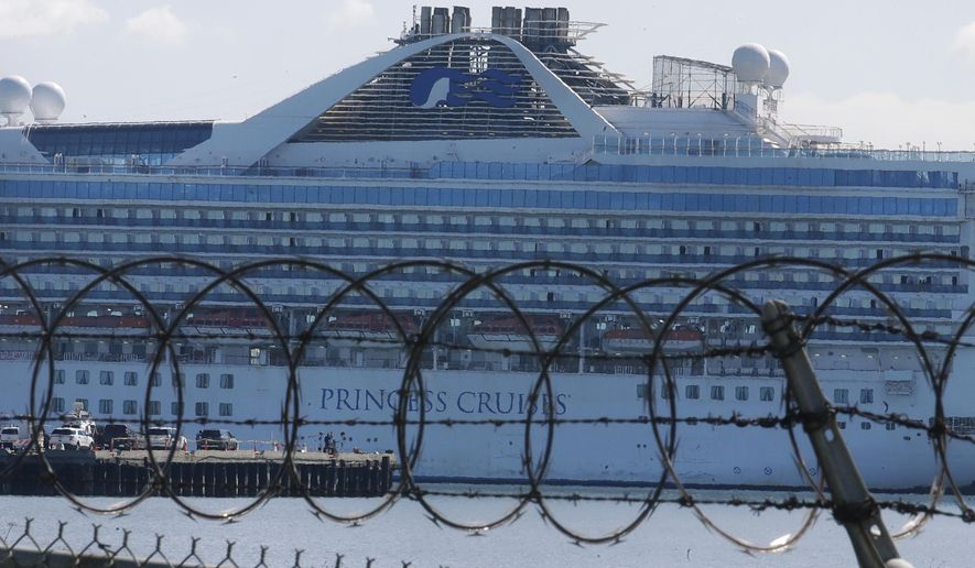 Wire fencing is shown in front of the Grand Princess cruise ship, which carried multiple people who have tested positive for COVID-19, docked at the Port of Oakland in Oakland, Calif., Wednesday, March 11, 2020. (AP Photo/Jeff Chiu)