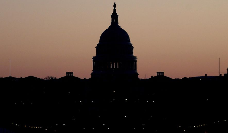 FILE - This Dec. 18, 2019, file photo shows the U.S. Capitol building is seen before sunrise on Capitol Hill in Washington. Congress is shutting the Capitol to the public until April in reaction to the spread of the coronavirus, officials announced Thursday, March 12, 2020, a rare step that underscores the growing gravity with which the government is reacting to the viral outbreak. (AP Photo/Julio Cortez, File)