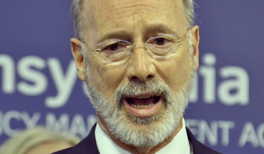 Gov. Tom Wolf of Pennsylvania speaks at a new conference at Pennsylvania Emergency Management Headquarters where he said he was ordering schools and other facilities to close in a suburban Philadelphia county, Montgomery County, that has been hard-hit by the COVID-19, Thursday, March 12, 2020 in Harrisburg, Pa. (AP Photo/Marc Levy)