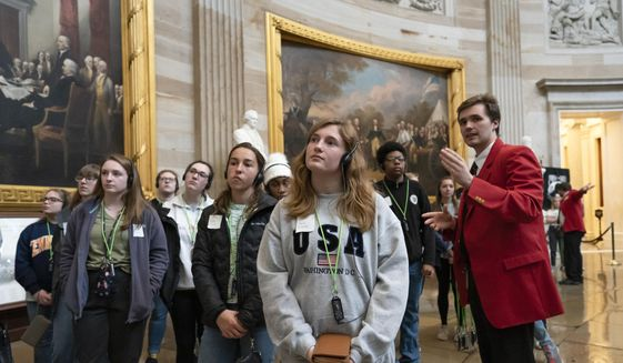 Students from Saint John Paul II Catholic High School in Huntsville, Ala., visit the Capitol Rotunda in Washington, Wednesday, March 11, 2020. (AP Photo/J. Scott Applewhite)  **FILE**