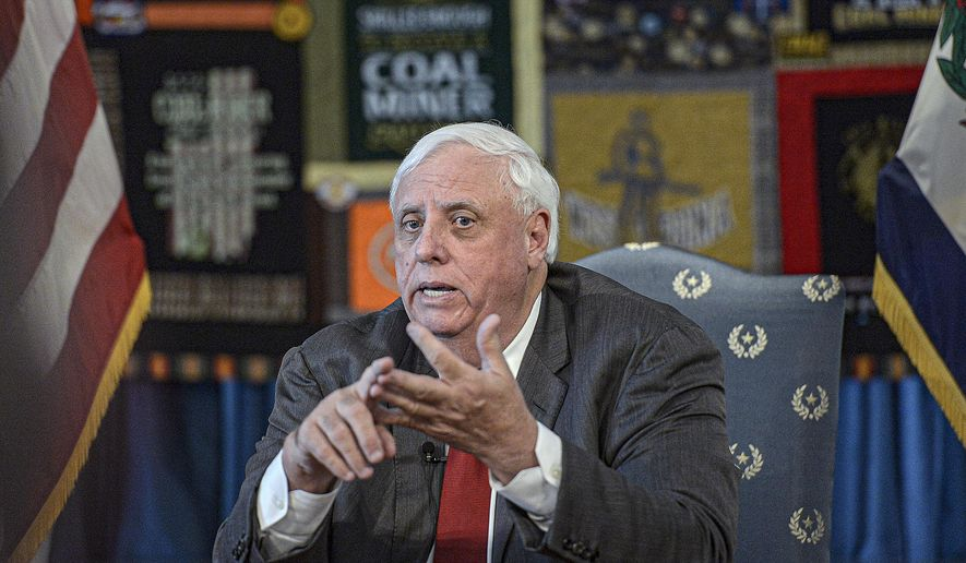 West Virginia Governor Jim Justice holds a press conference at the West Virginia State Capitol in Charleston, on Thursday, March 12, 2020 announcing the state's plans in dealing with the COVID-19 virus. (F. Brian Ferguson/Charleston Gazette-Mail via AP)