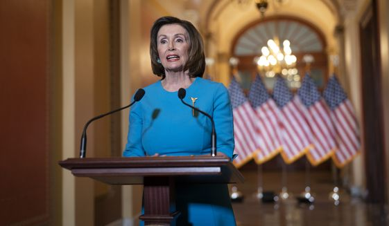 Speaker of the House Nancy Pelosi, D-Calif., makes a statement about a coronavirus aid package, on Capitol Hill in Washington, Friday, March 13, 2020. (AP Photo/J. Scott Applewhite)