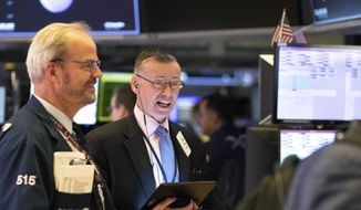 Traders work at the New York Stock Exchange, Friday, March 13, 2020. Stocks are opening sharply higher on Wall Street a day after the worst drop since 1987.(AP Photo/Mark Lennihan)