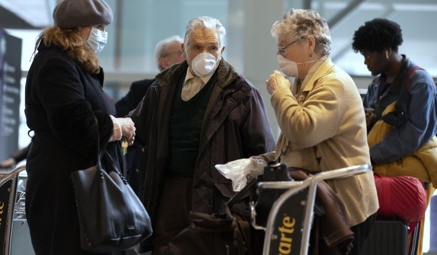 Passengers arrive on a flight from Germany at Logan International Airport in Boston, Friday, March, 13, 2020. Beginning at midnight Friday most Europeans will be banned from entering the United States for 30 days to try to slow down the spread of the coronavirus. Americans returning from Europe will be subject to enhanced health screening. For most people, the new coronavirus causes only mild or moderate symptoms, such as fever and cough. For some, especially older adults and people with existing health problems, it can cause more severe illness, including pneumonia. The vast majority of people recover from the new virus. (AP Photo/Michael Dwyer)