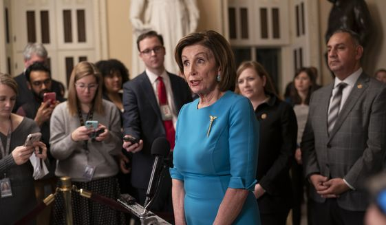 Speaker of the House Nancy Pelosi, D-Calif., makes a statement ahead of a planned late-night vote on the coronavirus aid package deal the Trump administration, at the Capitol in Washington, Friday, March 13, 2020. (AP Photo/J. Scott Applewhite)