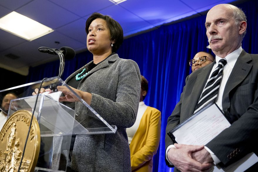 District of Columbia Mayor Muriel Bowser, accompanied by DC Council Chairman Phil Mendelson, right, speaks at a news conference on city updates in response to the coronavirus at the University of the District of Columbia Community College, Friday, March 13, 2020, in Washington. (AP Photo/Andrew Harnik) **FILE**