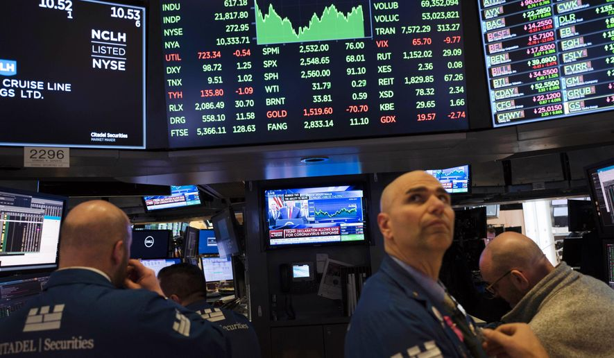 Traders listen at the New York Stock Exchange to President Donald Trump's televised speech from the White House, Friday, March 13, 2020, in New York. (AP Photo/Mark Lennihan) ** FILE **