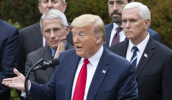 President Donald Trump, accompanied by Dr. Anthony Fauci, director of the National Institute of Allergy and Infectious Diseases, left, and Vice President Mike Pence, right, speaks during a news conference about the coronavirus in the Rose Garden at the White House, Friday, March 13, 2020, in Washington. (AP Photo/Alex Brandon)