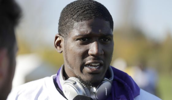FILE - In this Oct. 27, 2017, file photo, Minnesota Vikings cornerback Xavier Rhodes speaks to the media after taking part in an NFL training session at the London Irish rugby team training ground in the Sunbury-on Thames suburb of south west London. The salary-cap-strapped Minnesota Vikings have terminated the contracts of two long-time starters: nose tackle Linval Joseph and cornerback Xavier Rhodes. The move will clear more than $18.5 million off the team's salary cap. (AP Photo/Matt Dunham, File)