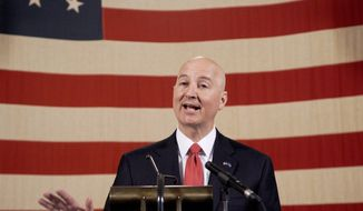Nebraska Gov. Pete Ricketts speaks during a news conference with State business and education leaders in Lincoln, Neb., Friday, March 13, 2020. Nebraska state officials have now confirmed 13 cases of the new coronavirus and developed a plan to order school closures for six to eight weeks if the outbreak worsens. For most people, the new coronavirus causes only mild or moderate symptoms. For some it can cause more severe illness. (AP Photo/Nati Harnik)