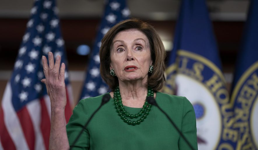 Speaker of the House Nancy Pelosi, D-Calif., updates reporters as lawmakers continue work on a coronavirus aid package, on Capitol Hill in Washington, Thursday, March 12, 2020. (AP Photo/J. Scott Applewhite) ** FILE **