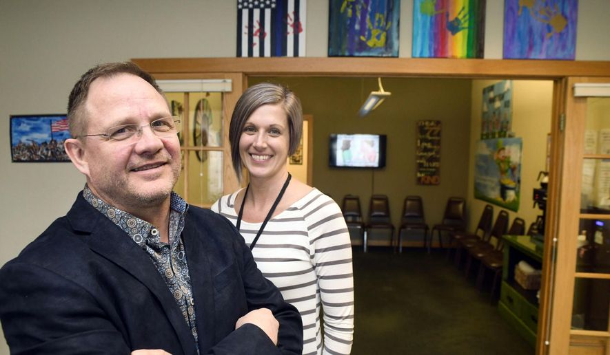 Kurt Snyder, executive director of the Heartview Foundation, and Jessica Brewster, director of the opioid treatment program in Bismarck, pose inside the treatment facility's waiting room on March 5, 2020. Heartview's opioid treatment program serves about 150 people.  (Mike McCleary/The Bismarck Tribune via AP)