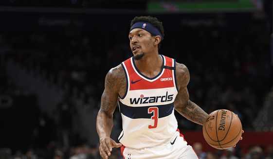 Washington Wizards guard Bradley Beal (3) dribbles the ball during the second half of an NBA basketball game against the Miami Heat, Sunday, March 8, 2020, in Washington. The Heat won 100-89. (AP Photo/Nick Wass) ** FILE **