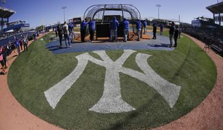 Toronto Blue Jays take batting practice before a baseball game against the New York Yankees Saturday, Feb. 22, 2020, in Tampa. (AP Photo/Frank Franklin II)