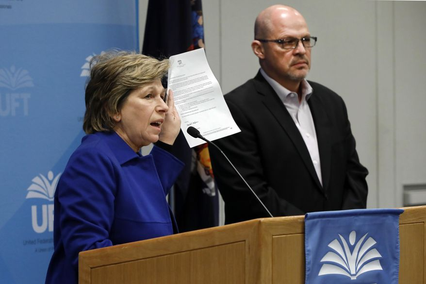 In this file photo, American Federation of Teachers President Randi Weingarten, and Michael Mulgrew, president of the United Federation of Teachers in New York City, address a news conference at UFT headquarters, in New York, Sunday, March 15, 2020.  (AP Photo/Richard Drew)  **FILE**